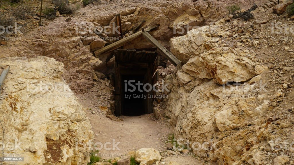 Entrance to a gold mine in old west stock photo