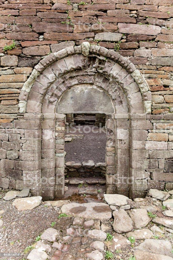 Entrance to a ruined 12th Century Catholic Church in Ireland stock photo