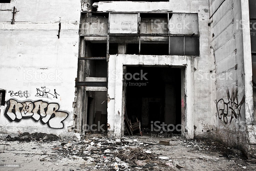 Entrance to an abandoned industrial building stock photo
