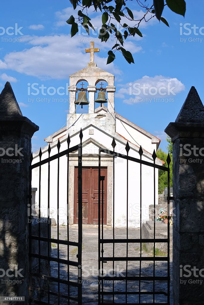 Entrance to cementary with chapel stock photo
