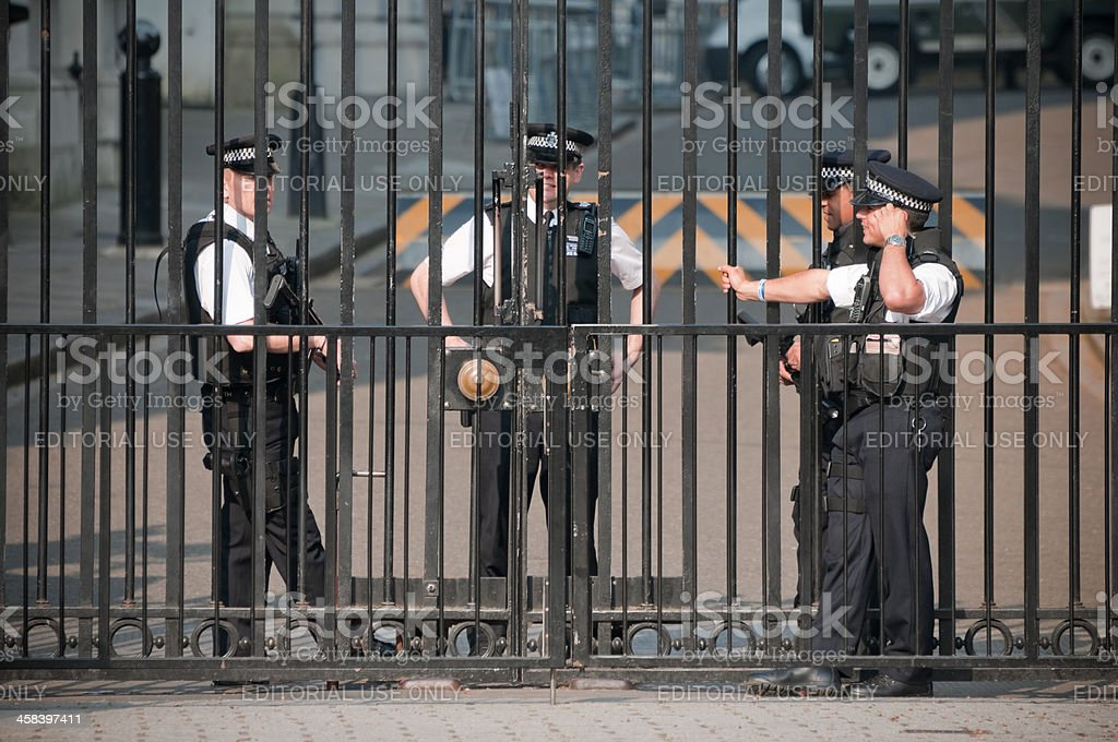Entrance to Downing Street guarded by armed policemen, London stock photo