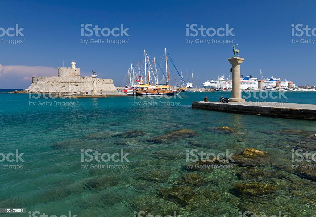 Entrance to Rhodes harbor stock photo