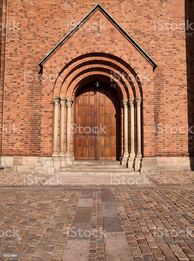 Entrance to Roskilde Cathedral stock photo