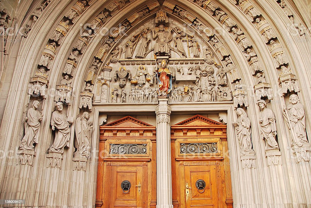 Entrance to St Nicholas Cathedral, Fribourg royalty-free stock photo