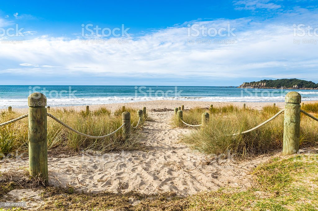 Entrance to the beach in sunny day stock photo