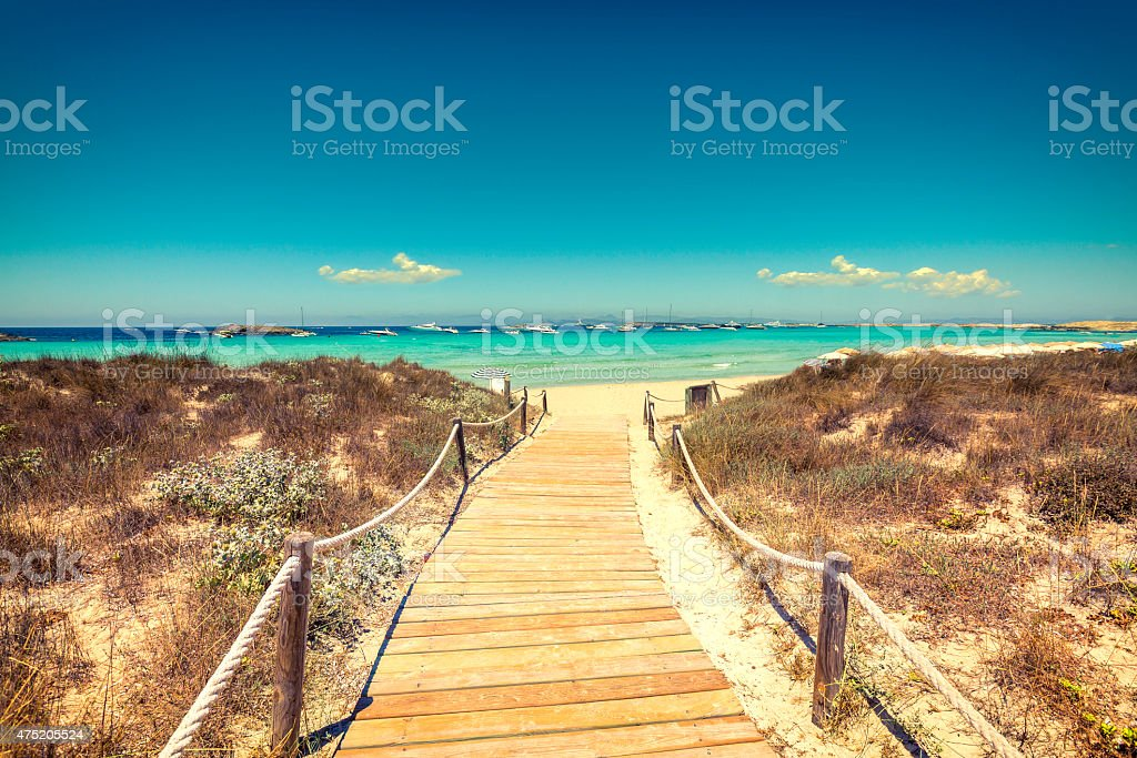 Entrance to the beach with wooden walkway stock photo