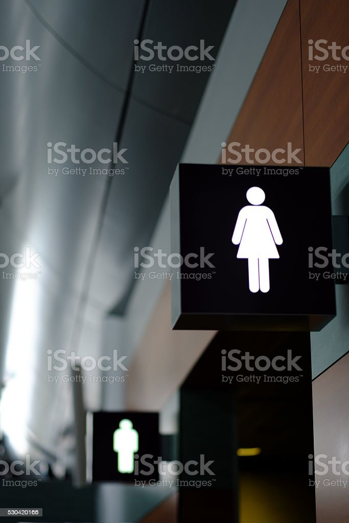 entrance to the male and female toilet. Sign in airport stock photo