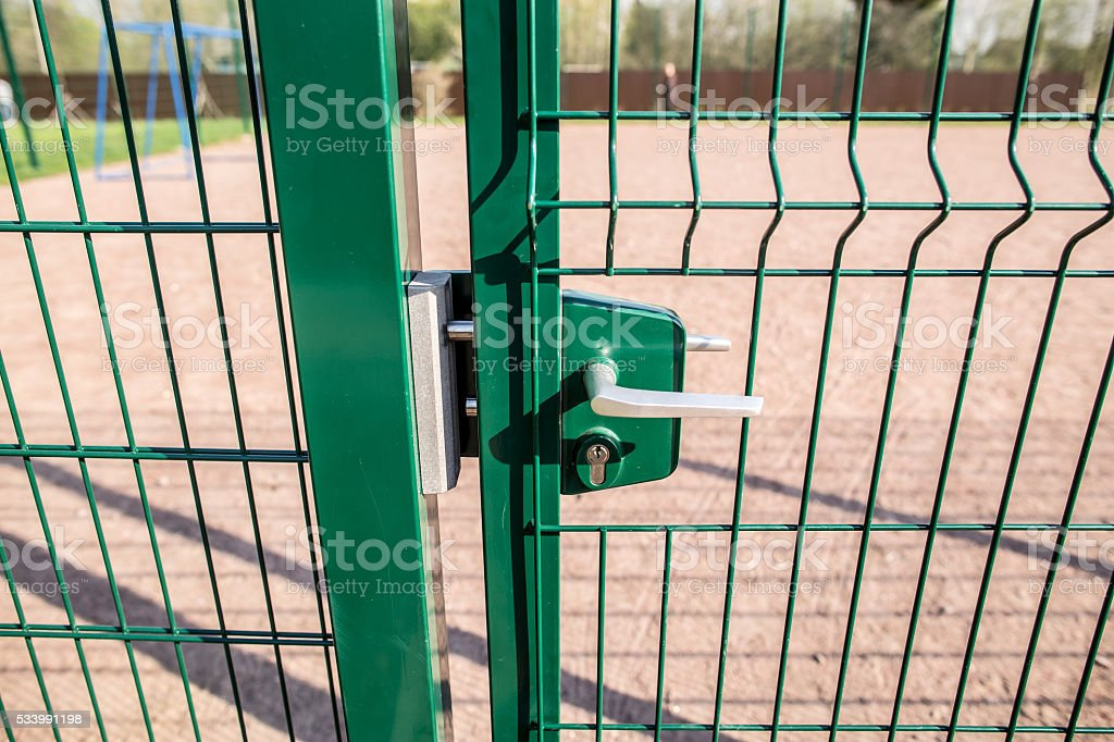entrance to the playground of fence and the wicket ofwelded stock photo
