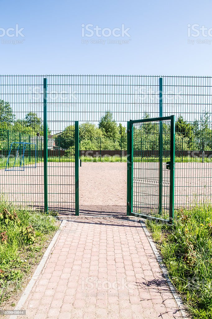 entrance to the playground of fence stock photo