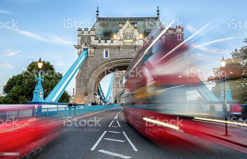 Entrance to the Tower Bridge of London with blurred Bus stock photo