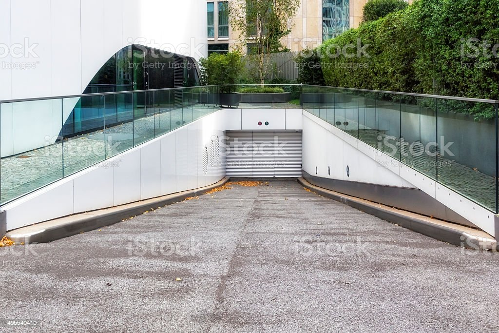 Entrance to the underground parking garage stock photo