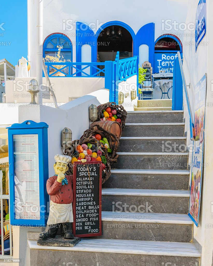 Entrance to traditional Greek tavern with figure of cook stock photo