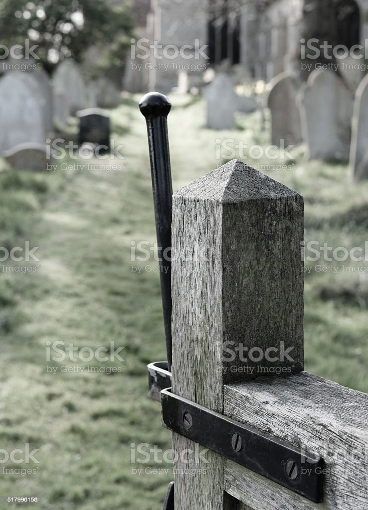 Entrance via a wooden gate to an English cemetery stock photo