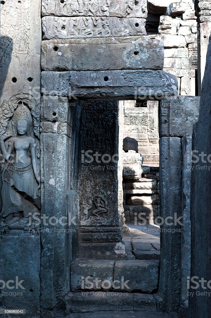 Entrance with stone carvings on wall at Angkor Wat stock photo