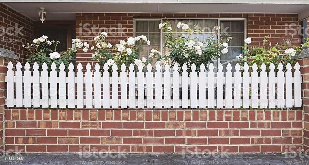 entrance with white fence royalty-free stock photo