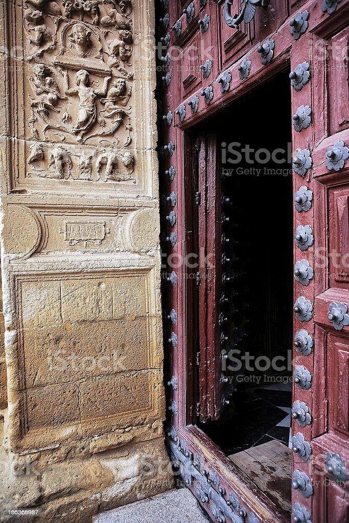 Entrance wooden door to the chapel of El Salvador stock photo