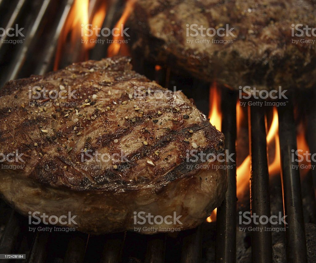 Entrecote Ribeye steak and fire royalty-free stock photo