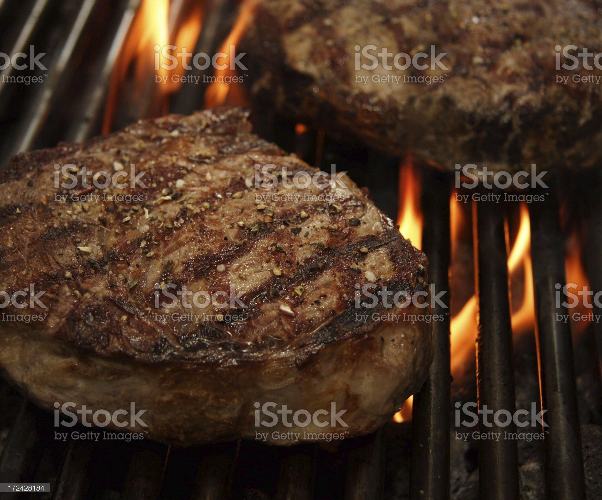 Entrecote Ribeye steak and fire royalty-free stock photo