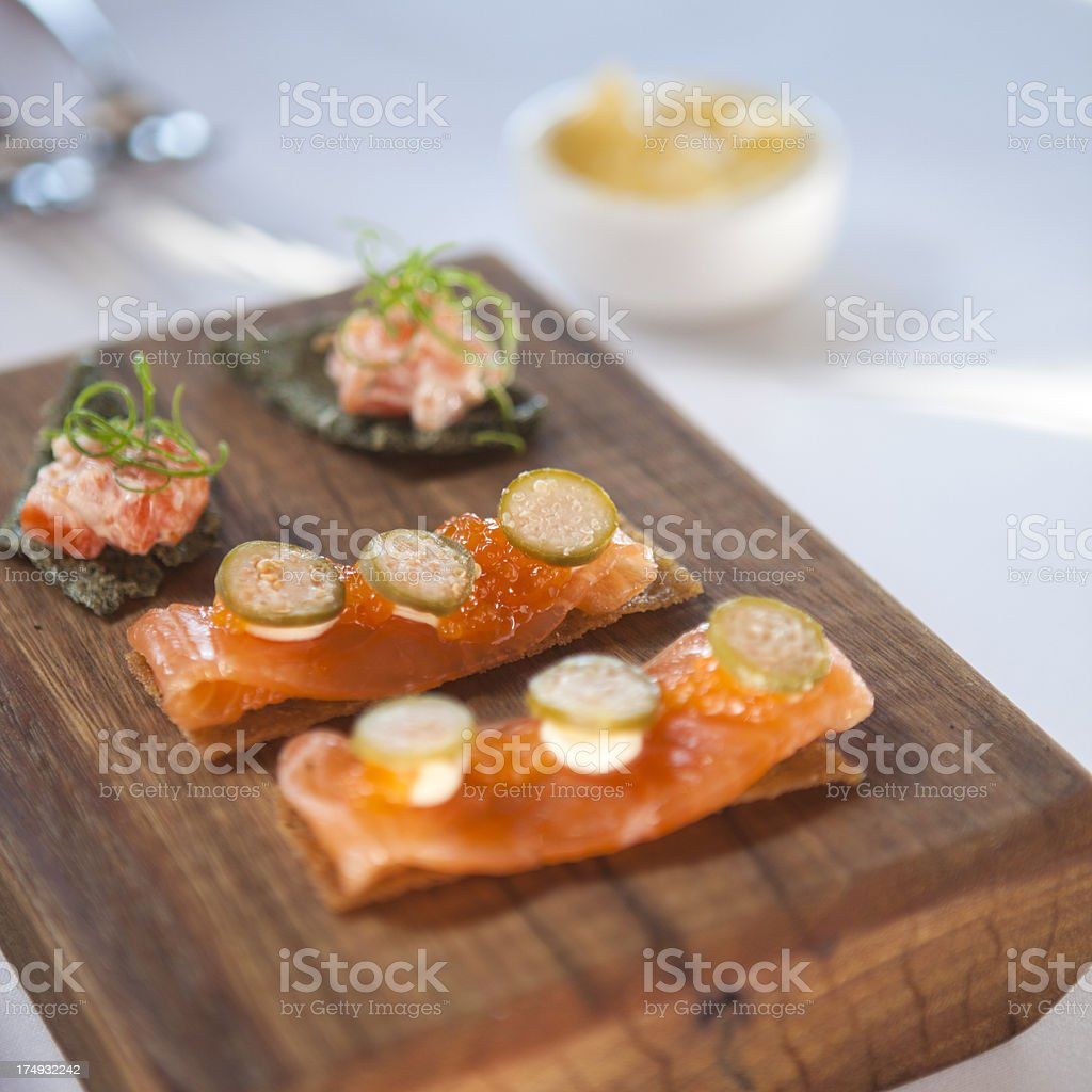 Entree of smoked salmon, capers, cream cheese and crackers royalty-free stock photo