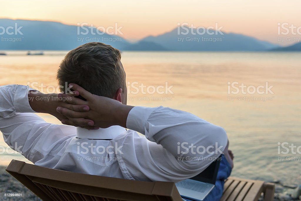entrepreneur enjoys staying on the beach stock photo