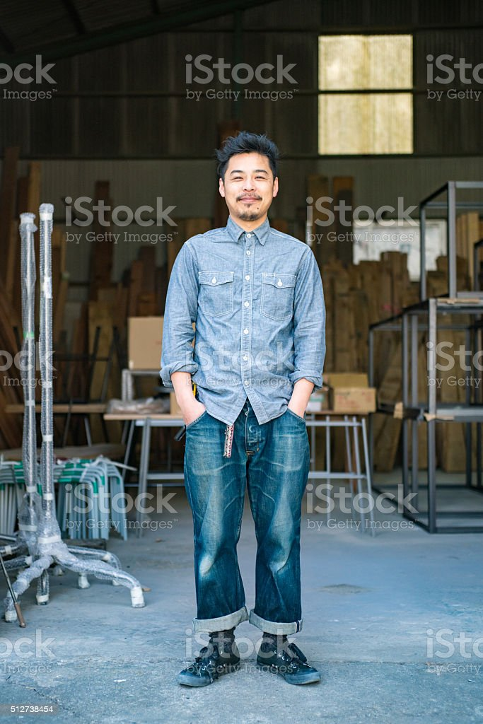 Entrepreneur in his thirties in a small business environment stock photo