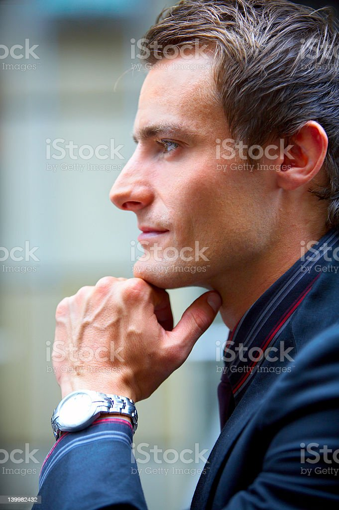 Entrepreneur looking away in thought royalty-free stock photo