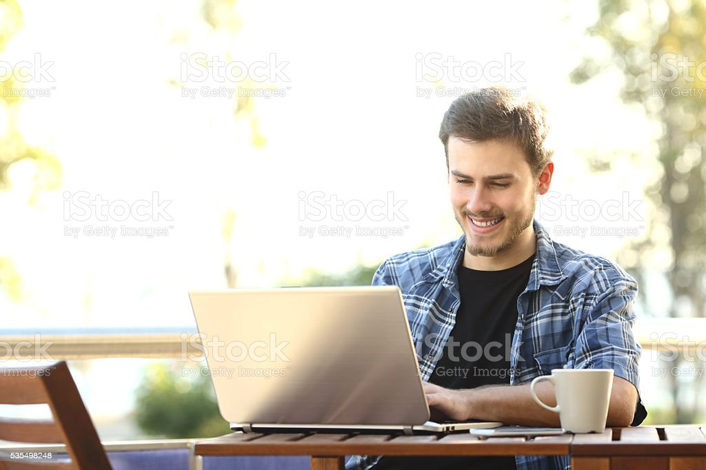 Entrepreneur man working with a laptop stock photo