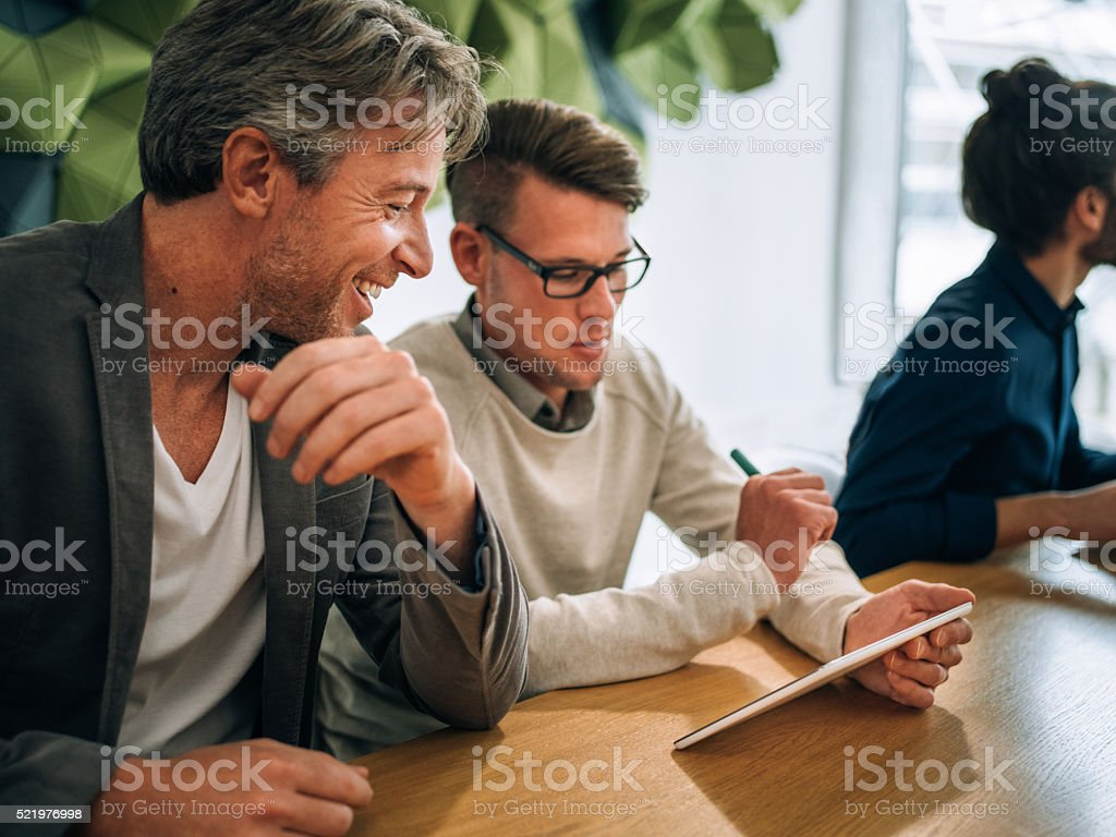Entrepreneur meeting young business people for conference in office stock photo