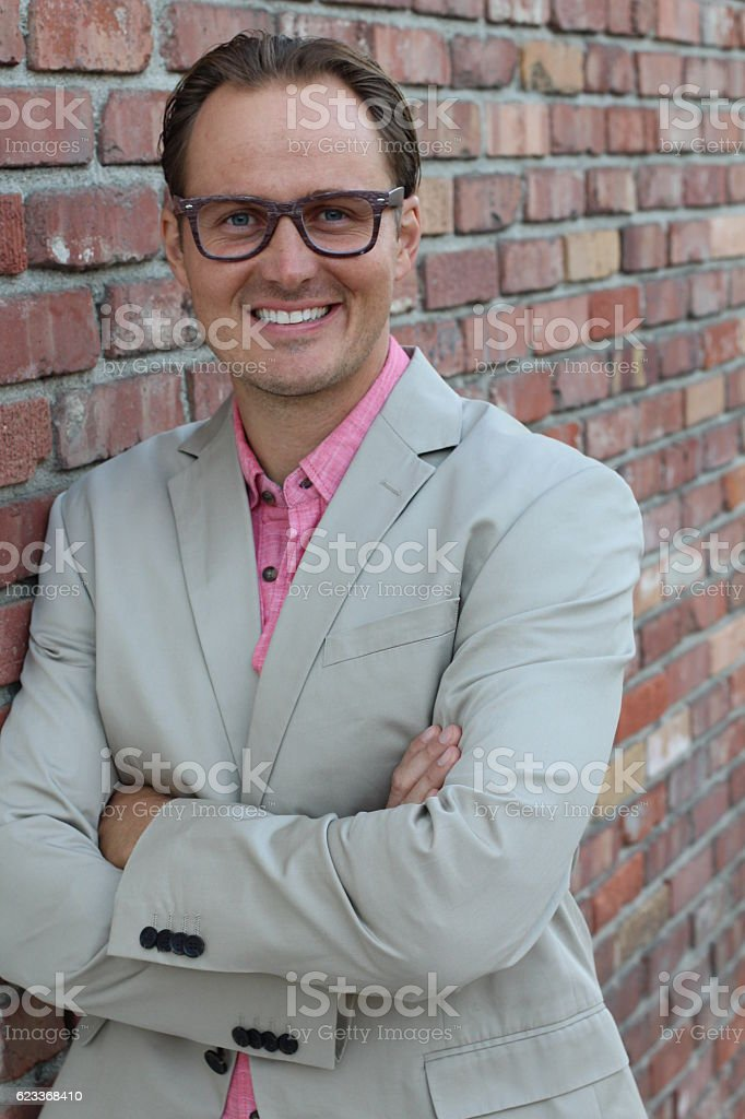 Entrepreneur smiling. Confident, happy and successful stock photo