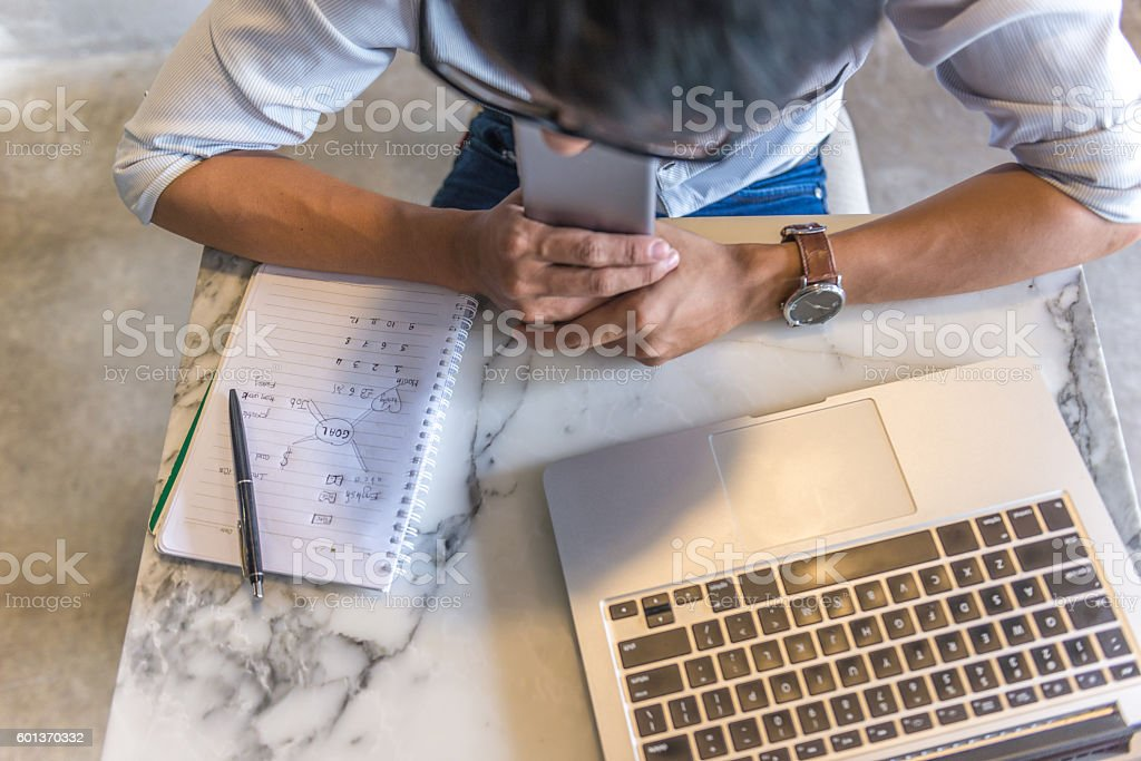 Entrepreneur thinking of how to increase sales volume for business stock photo