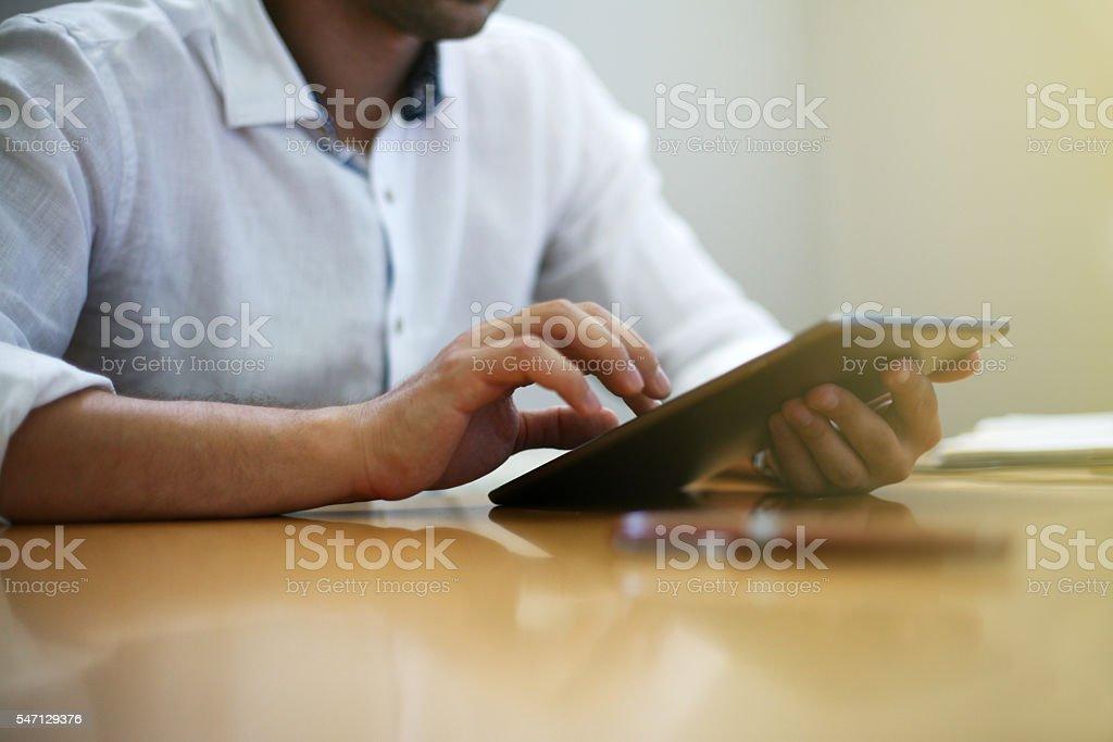 Entrepreneur working on digital tablet. stock photo