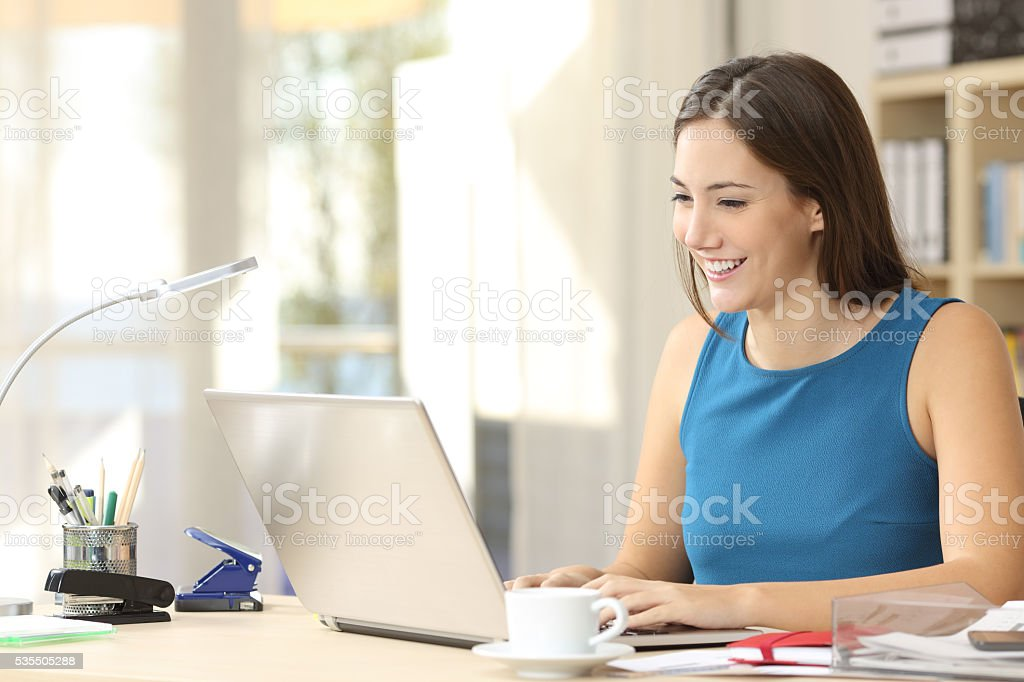 Entrepreneur working with a laptop at office stock photo
