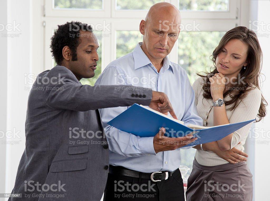 Entrepreneurs Looking at a Binder royalty-free stock photo