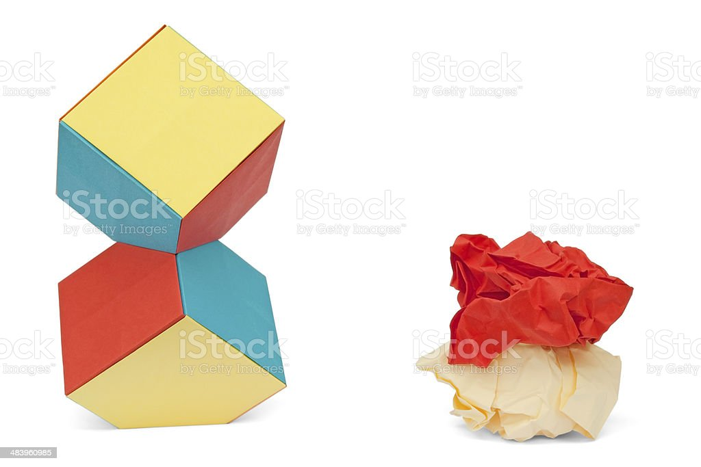 Entropy metaphor with paper cubes and paper balls royalty-free stock photo