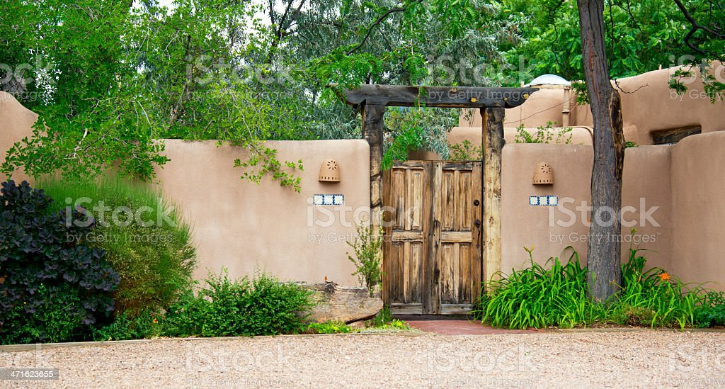 Entry Door to Southwest Santa Fe Adobe Stucco House royalty-free stock photo