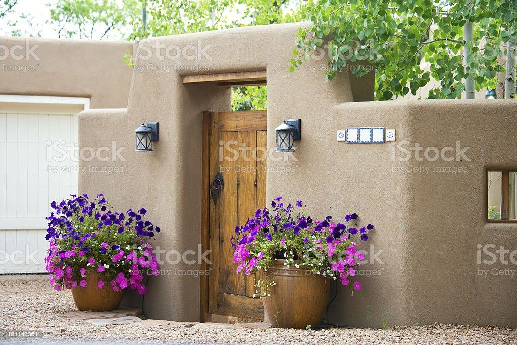 Entry Door to Southwest Santa Fe Pueblo-Style Adobe House royalty-free stock photo
