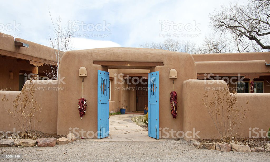 Entry Door to Southwest Santa Fe Pueblo-Style Adobe House stock photo