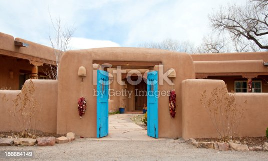 Entry door to southwest santa fe pueblostyle adobe house for Pueblo style home plans