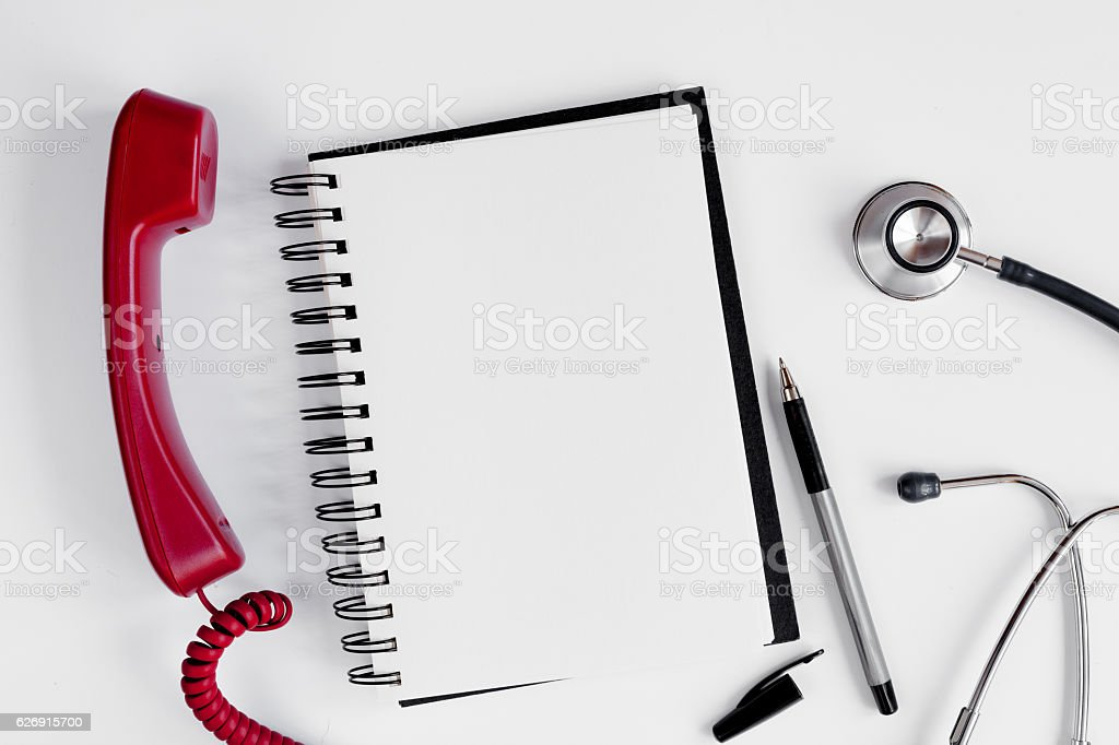 Entry to doctor blank open notebook with stethoscope top view stock photo