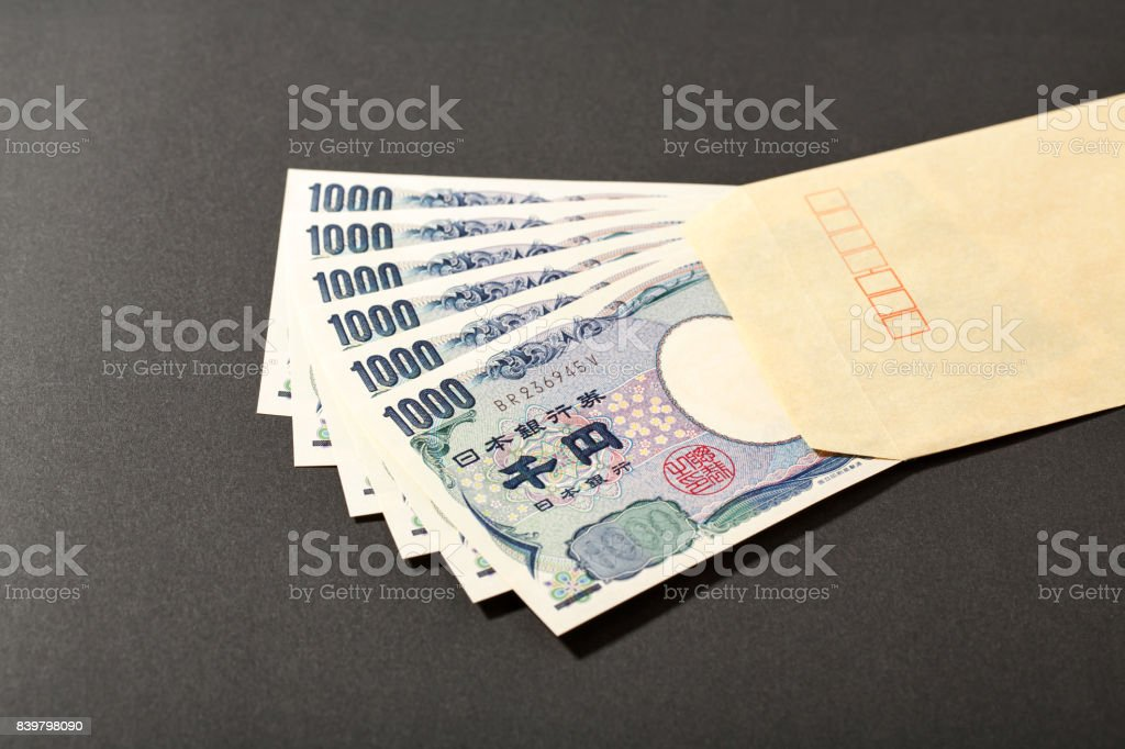 envelope and Japanese bank note 1000 yen stock photo