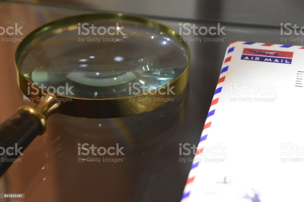 Envelope and magnifier stock photo
