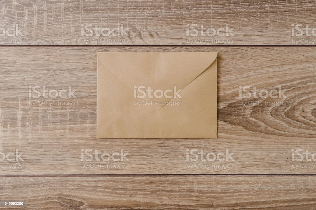 envelope on a wooden background stock photo