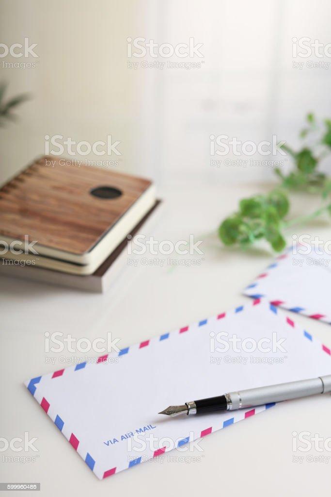 Envelope with pen stock photo