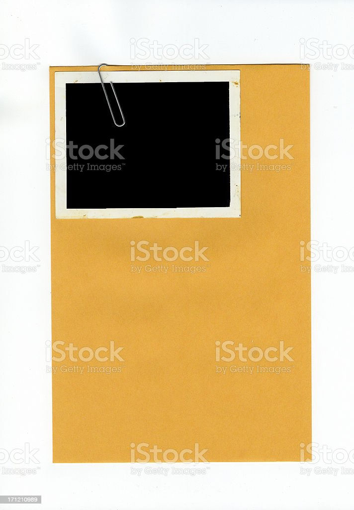 Envelope with Photo Attached by Paper Clip royalty-free stock photo