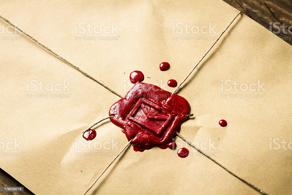 Envelope with red sealing wax and old thin rope stock photo