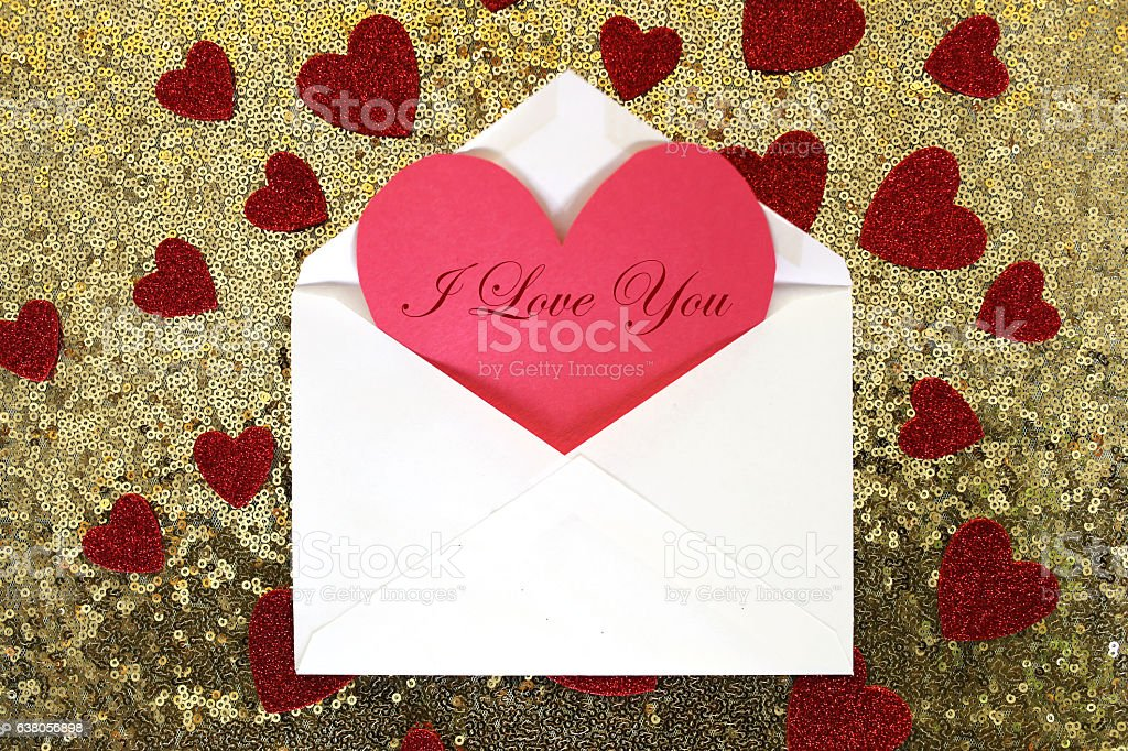 Envelope with Valentine's Day Heart Note and Confetti stock photo