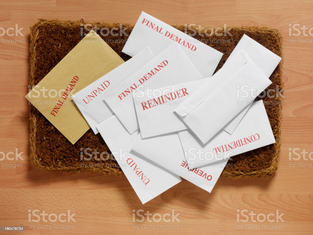 Envelopes and Bills on the Doormat stock photo