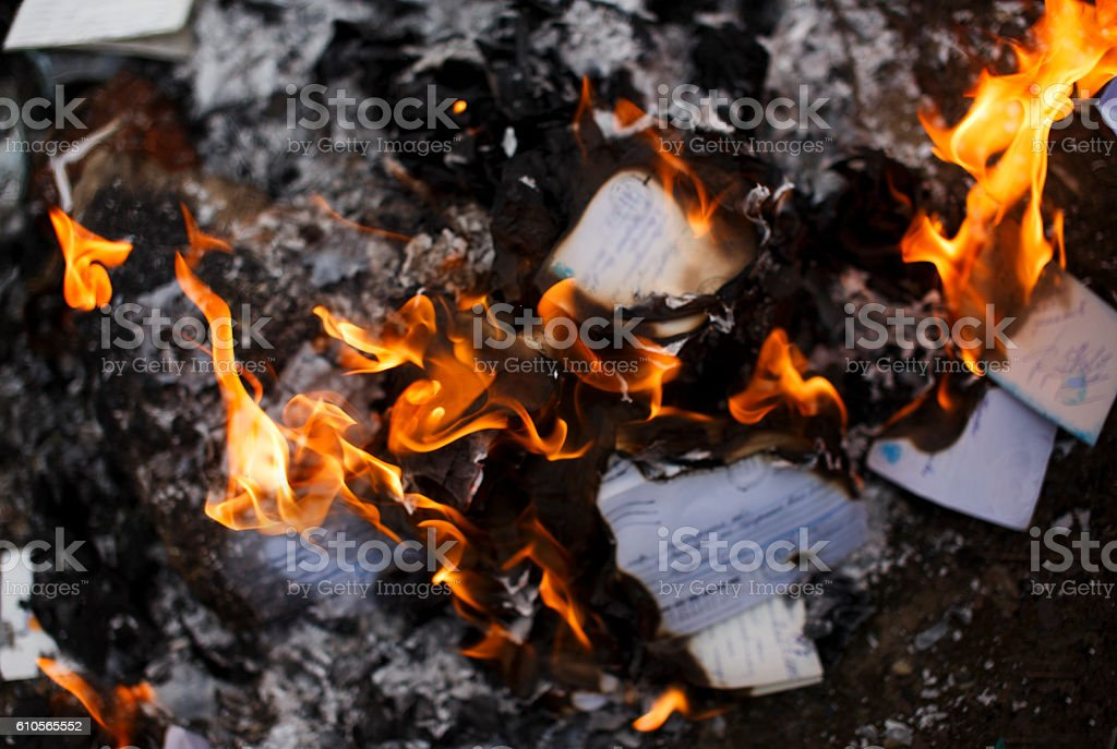 envelopes and letters on fire stock photo