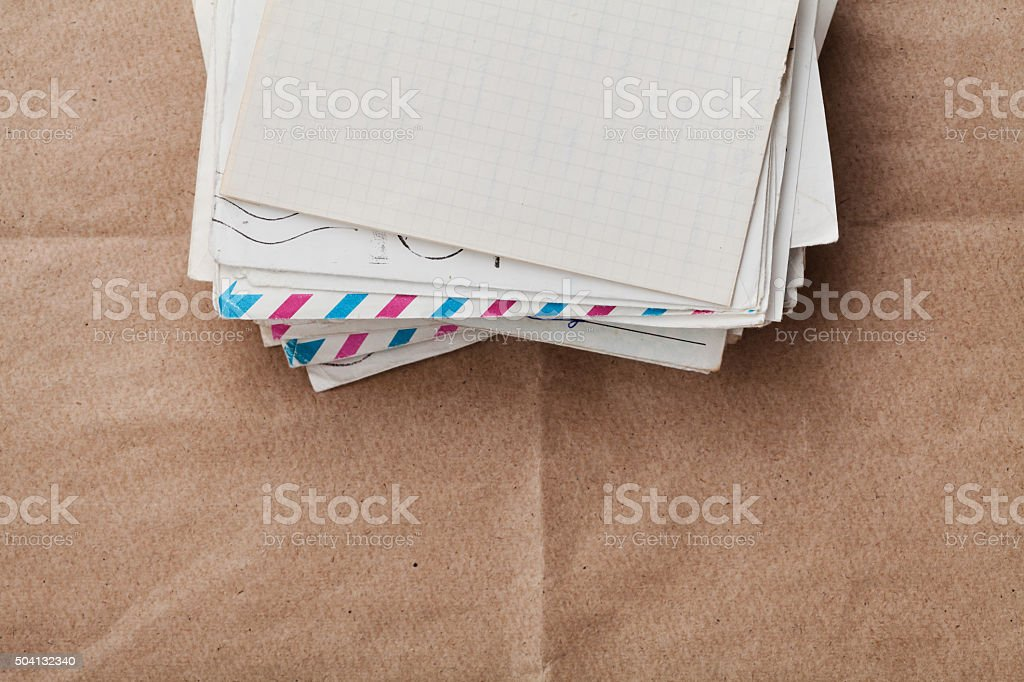 Envelopes and letters on kraft paper, top view, cope space stock photo