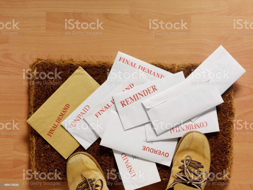 Envelopes on a Doormat royalty-free stock photo